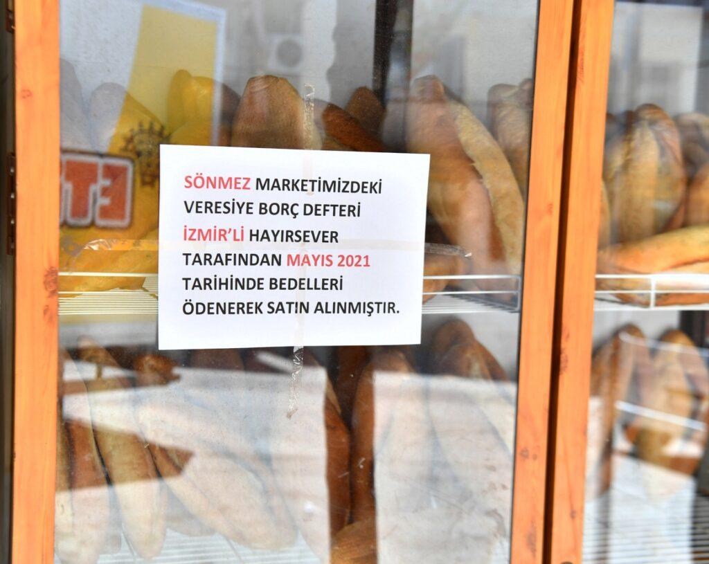İzmir Büyükşehir Başkanı Tunç Soyer'in başlattığı kampanyayla, 102 bakkalın veresiye defterlerinde birikmiş 1 milyon 300 bin liralık borç kapatıldı.